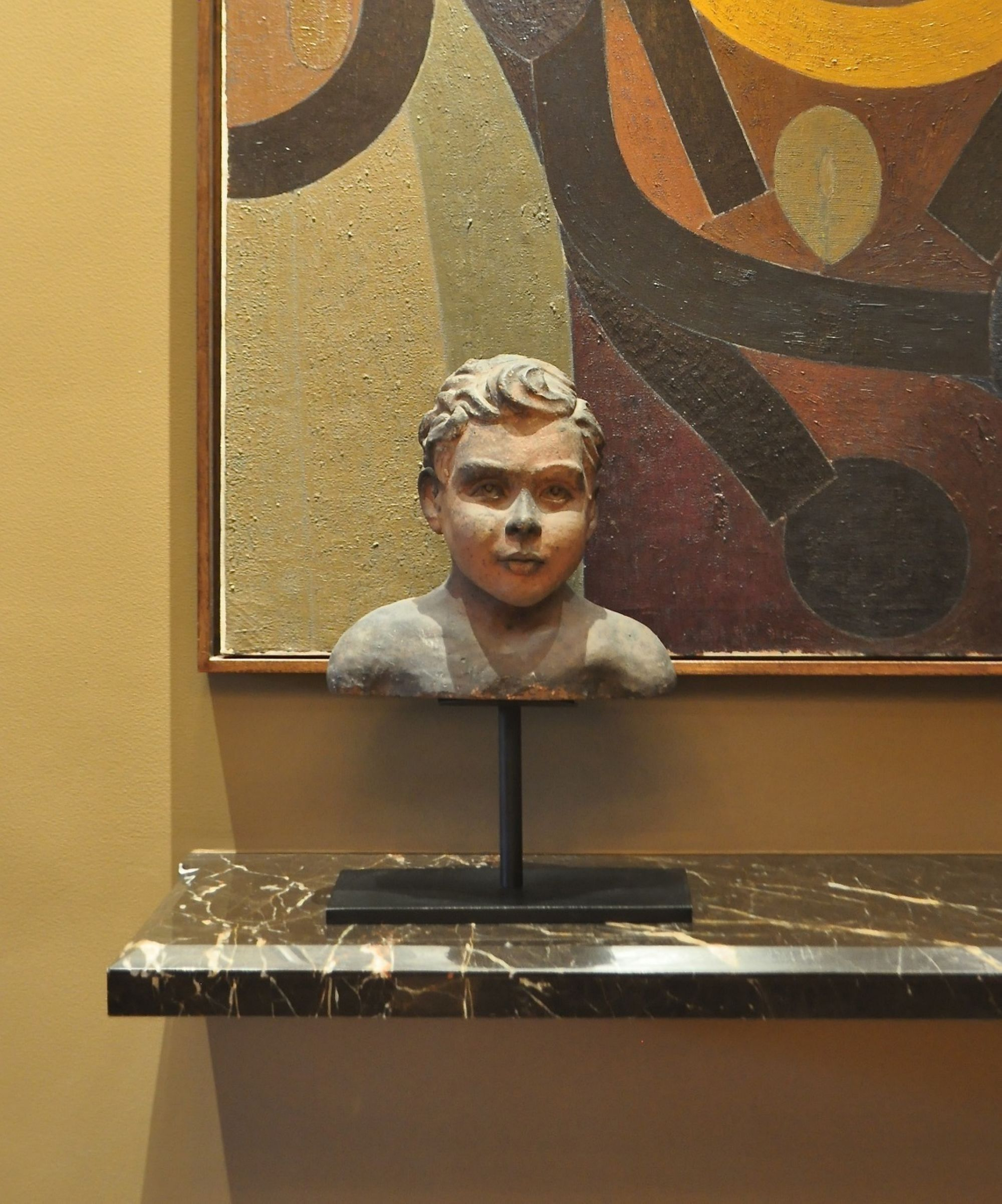 The terra cotta bust came beautifully mounted on a black steel stand.