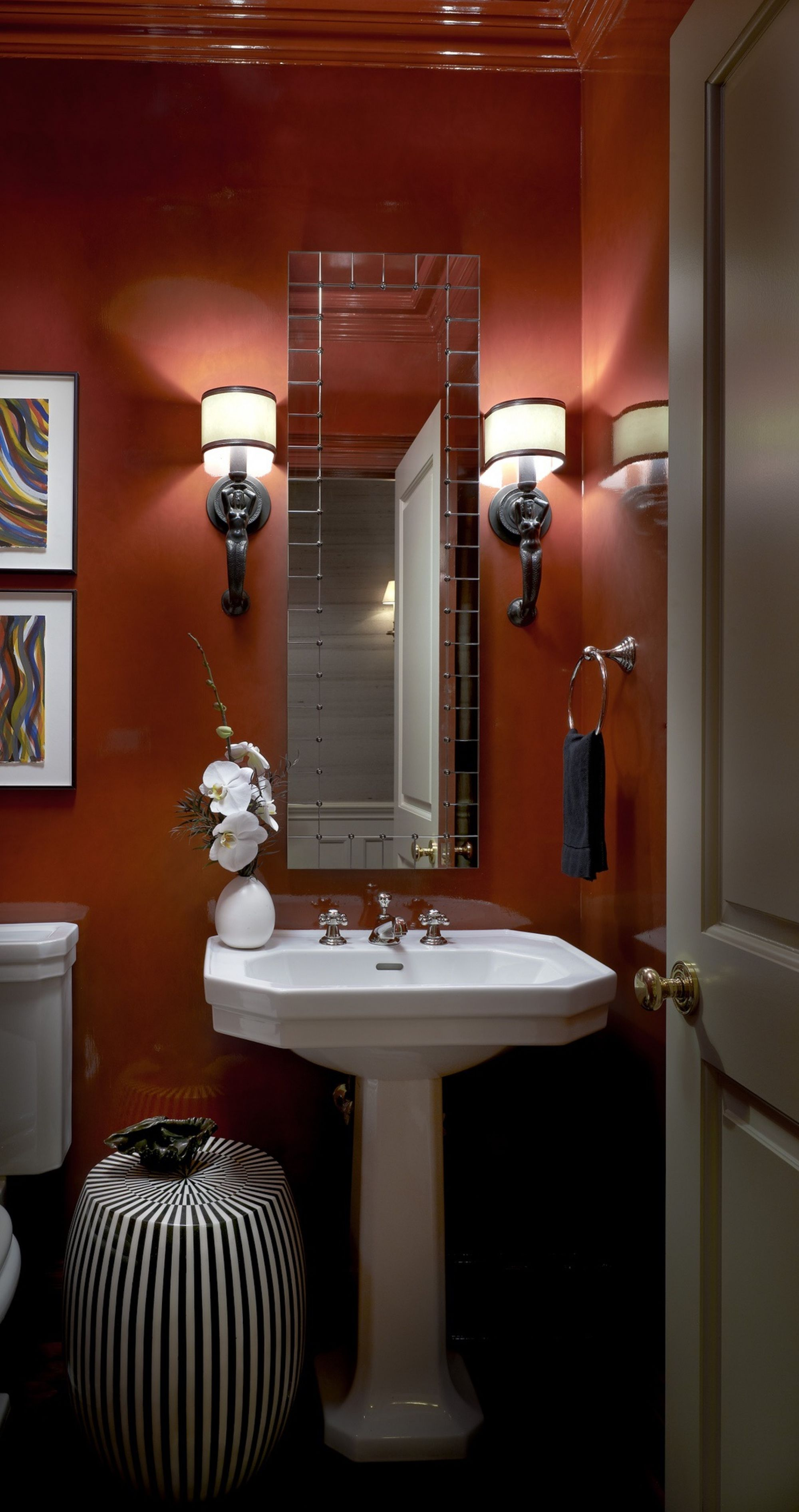 We used C2 Luxe Paint's Audacious in gloss to amplify the glamor and dimensions of this tiny powder room in a vintage building. Project: Astor Street Residence