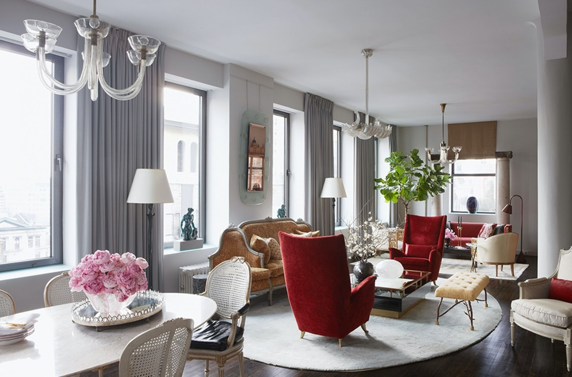 A personality-laden pair of red chairs is transformational in the midst of the more sedate and traditional trappings in this home by D'AquinoMonaco. Photo: D'AquinoMonaco