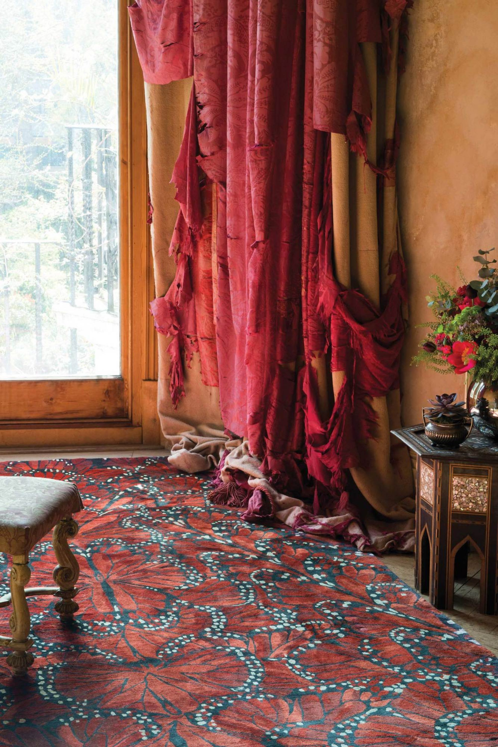 Deep red paired with black and white establish a classic color palette and put drama and passion underfoot at the same time. Photo: The Rug Company
