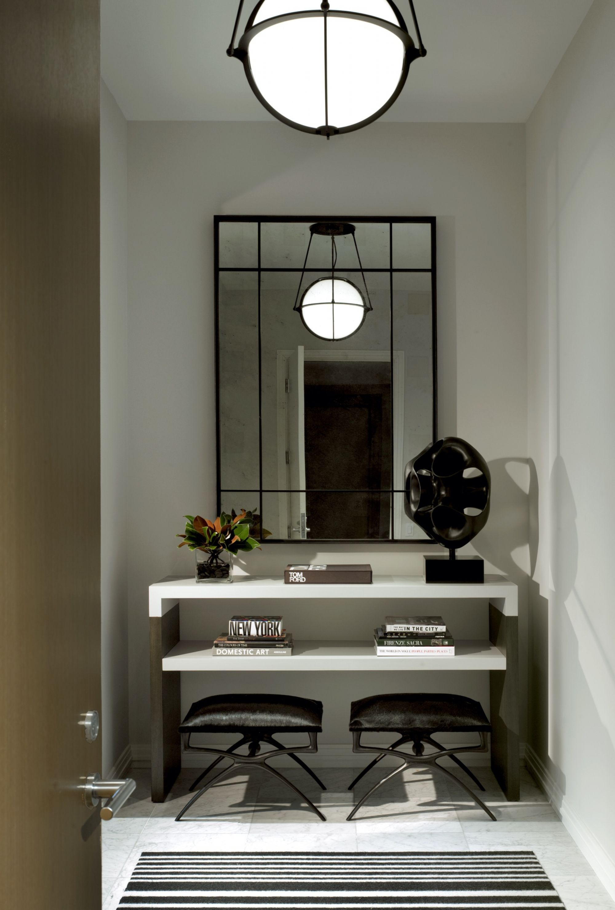 A tiny alcove becomes an impressive grand entrance with the right trappings. Photo: JLI Oak Street Pied-a-Terre