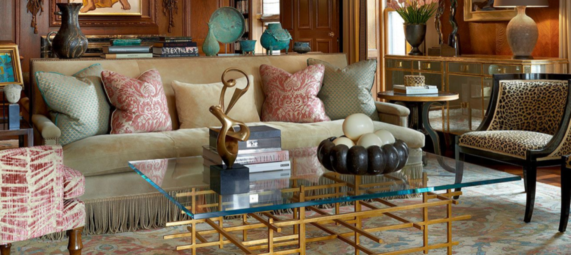 Opulent details, including sumptuous suede skins, brass nail heads and silk bullion fringe, up the grandeur on Richard Shapiro's Studiolo Club Sofa. (Image: Jessica Lagrange Interiors)