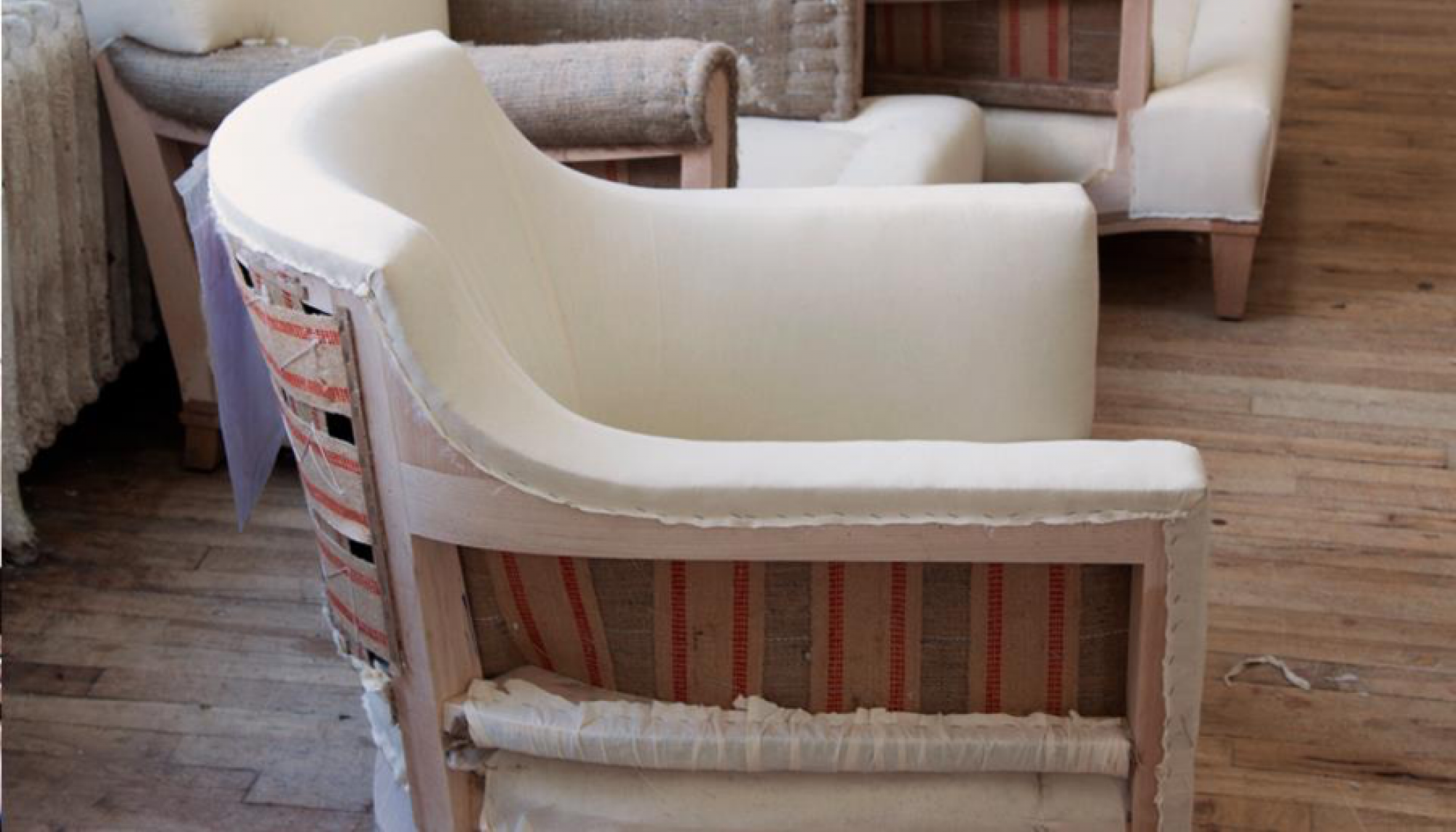 Layers of burlap, cotton and down, or foam if used, are covered with muslin to create a final form. (Image: Jonas Upholsterers)