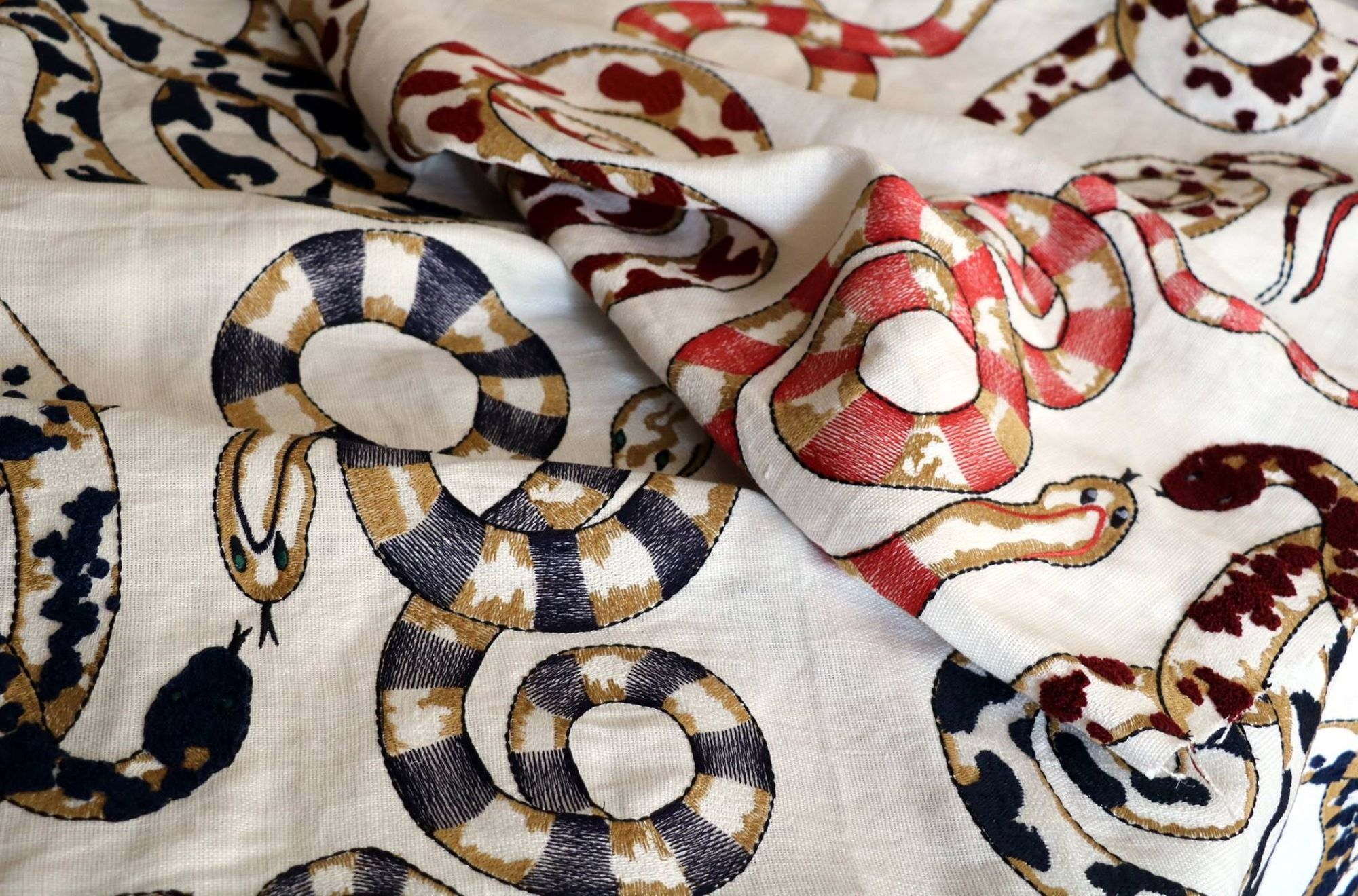 Snakes are having their moment on everything from fabrics and wallcoverings to significant pieces of furniture. One of our favorite items is linen sporting embroidered snakes (Venimeuses) from Pierre Frey. (Image: Pierre Frey)