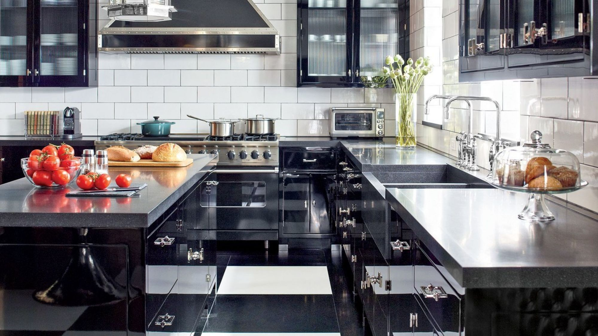 Instead of doing a new kitchen, we gave the traditional white cabinets a high-dose of glamor by painting them glossy black. A kitchen by New York designer Steven Gambrel was a source of inspiration. (Image: Steven Gambrel)